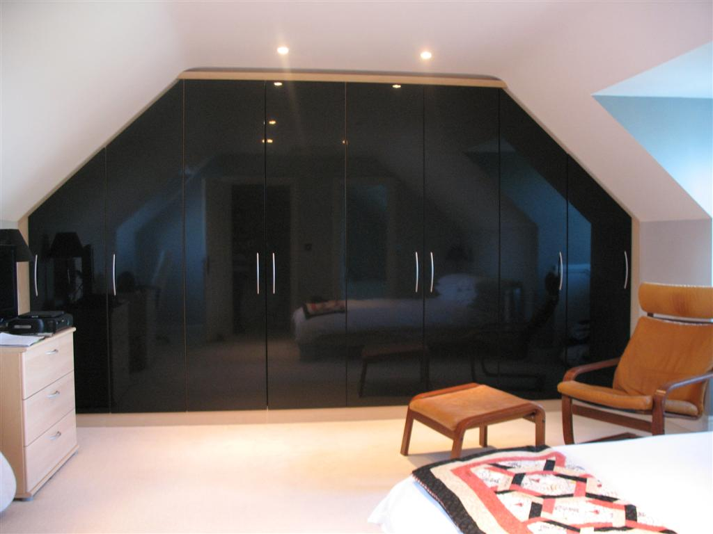 Bespoke angled robes in attic room