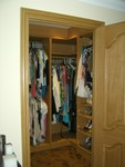 Light oak walk-in wardrobe interior